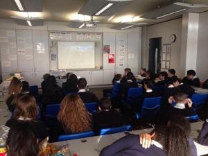 Fifty schoolchildren in their classroom watching the Internet stream of Richard II